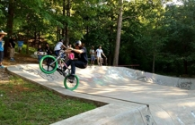 Bicycle riders on the bike ramp at Harmon Park